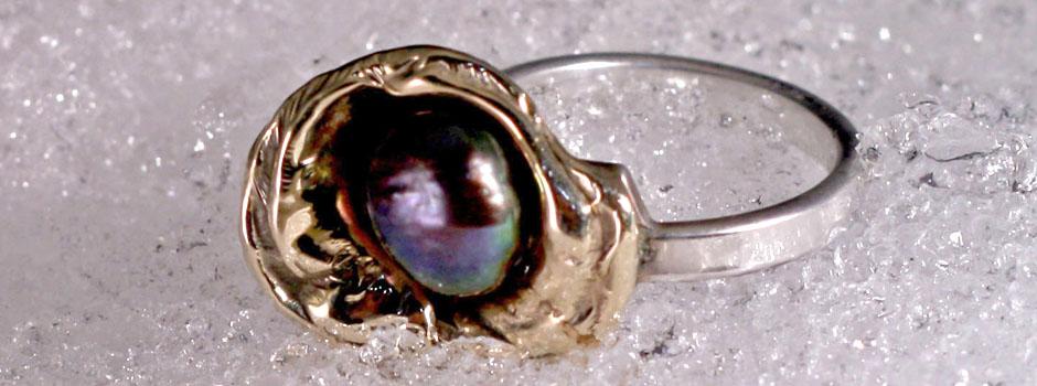 gouden ring met zwarte parel